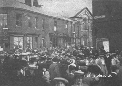 Crowds gather at the corner of Market Street and Stockport Road during Marple Carnival in 1906.