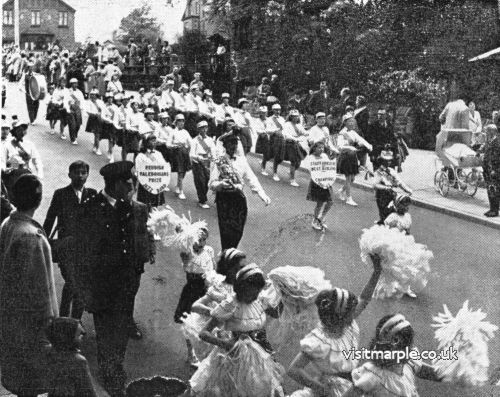 A troup of dancers make their way down Brabyns Brow