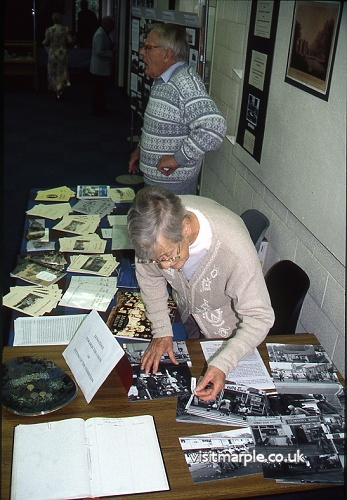 Volunteers at the Millennia Exhibition by MLHS in 2000.