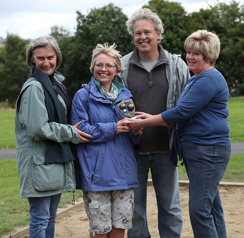 Kay Gould-Martin presents the trophy to Marple Civic Society's Gillian Postill, Jane and Graham Clarke