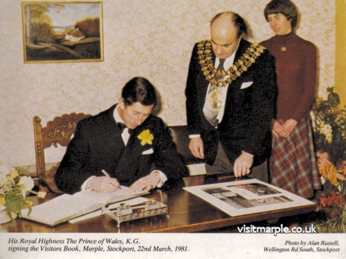 Prince Charles signs the guest book in 1981