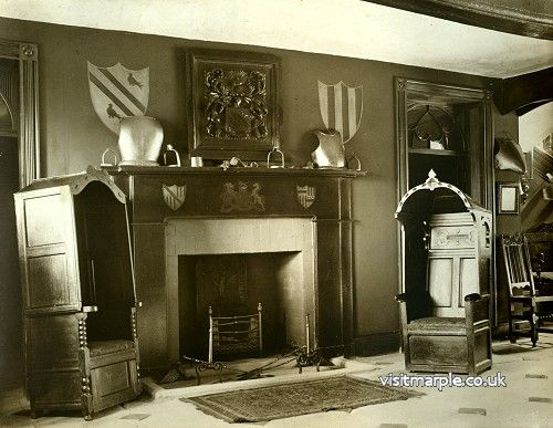 The fireplace and amazing chairs in the entrance hall of Marple Hall in 1919.