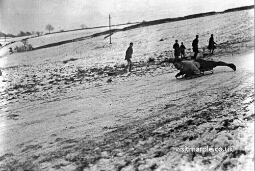 Tom Oldham sledging on Ale House Brow in the 1930s