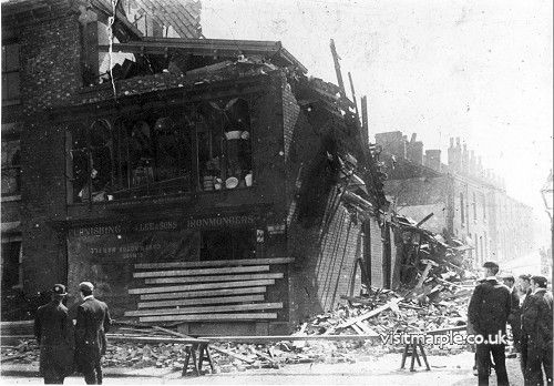 Crowds inspect the damage after explosion in 1902