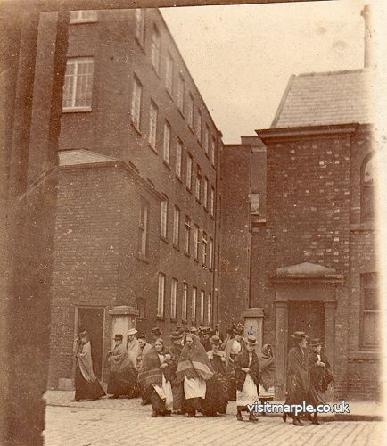 Workers leaving the Hollins Mill via the entrance on Stockport Road around 1890.