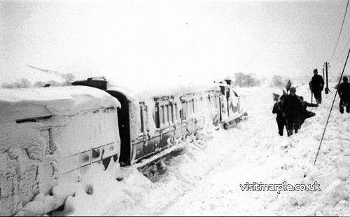 A train and ex G.C. C.13 4.4.2T locomotive snowed up near Torkington Lane between Rose Hill and High Lane in the 1947 winter.