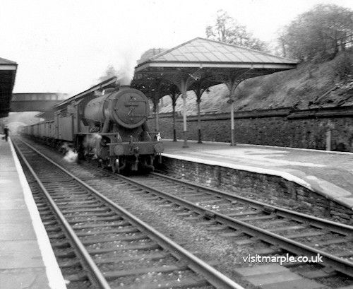 Marple Station. W.D. Austerity 2-8-0 (possibly no. 90312, a Gorton engine).