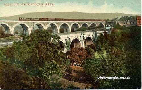 An Up Great Central train of 14 six-wheeled carriages headed by a diminutive tank engine crosses Marple Viaduct.