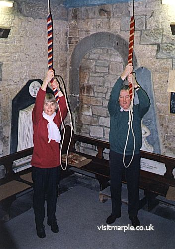 Campanologists Pamela Andrew and Peter Nicholson at work in the All Saints' tower